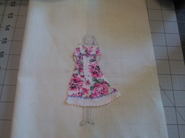 The back ground fabric is muslin and I sketched the body with a pencil. I also shorten the sleeves on the dress.